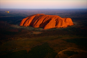Uluru./ Orange Uluru in bright beams of the sunset sun. Aerial photography.