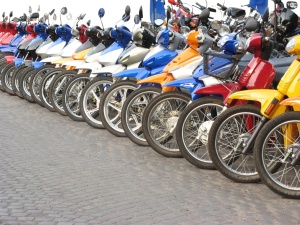 Group Of Motorcycles Aligned Together