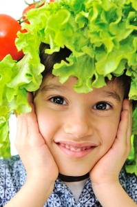 A Closer View of a Kid Wearing a Vegetable Head Dress