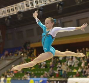 A Gymnast Flying High on a Rhythmic Gymnastics
