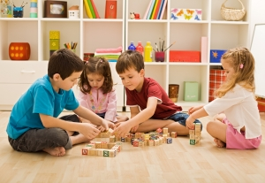 Group of Children Playing with Blocks in the Floor