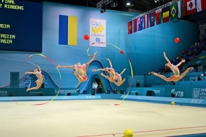 Group of Gymnasts Doing a Rhythmic Gymnastic Called Floor Exercise
