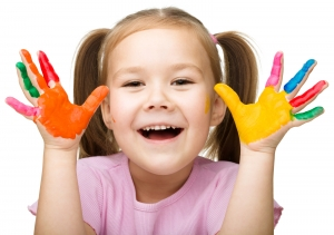Portrait of a Cute Cheerful Girl with Colorful Hands 43918411
