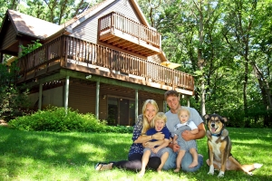 Portrait of a Happy Family in a Log Cabin House