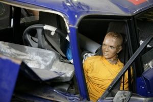 A Robot Dummy On A Car Crash Test