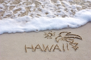 The Word Hawaii Written on a Sand by the Sea Shore