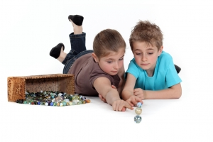 Children Playing with Marbles Isolate on White Background