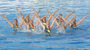 A Synchronize Swimming Team Performing in Olympics
