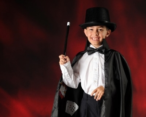 A Young Boy in a Complete Magician Outfit