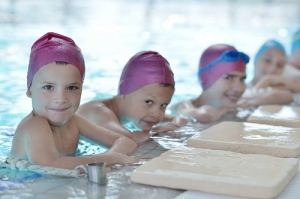 Happy Children in a Swimming Class