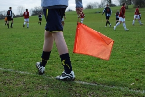 Linesman Watching Closely if the Ball Went Out of the Field Boundary