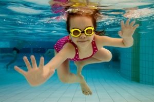 The Girl Smiles While Swimming Underwater